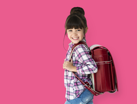 Young asian kid student with a backpack studio portrait 版權商用圖片
