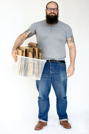 Man standing and holding box of cardboard