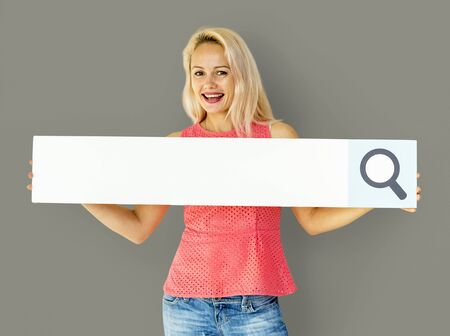 Woman holding paper search bar and smiling Stock Photo