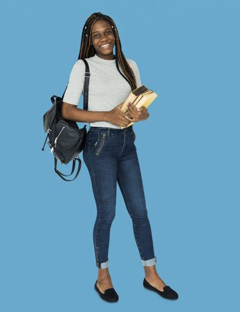 African girl student smiling and holding textbook Stock Photo - 80306780