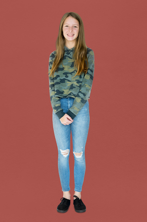 Teenage girl smiling casual studio portrait