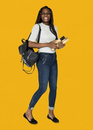 African girl student smiling and holding textbook Stock Photo - 80277053