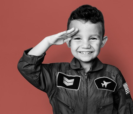 Little boy with pilot dream job salute and smiling Banco de Imagens - 80259912
