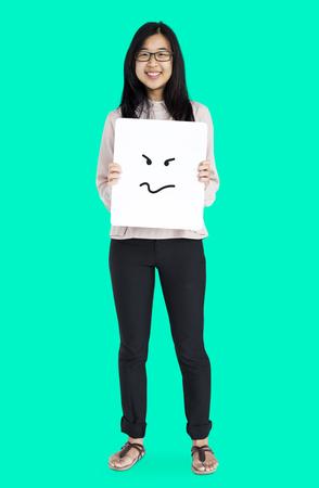 Asian girl holding placard studio portrait Stock Photo - 80307841