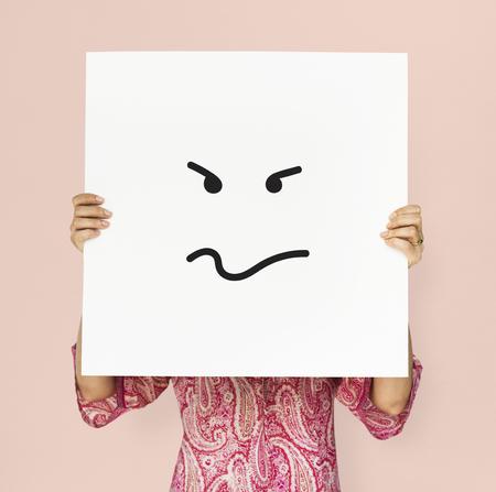 Adult woman holding placard studio portrait