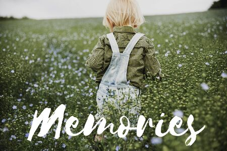 reminisce: Memories word on young boy outdoors