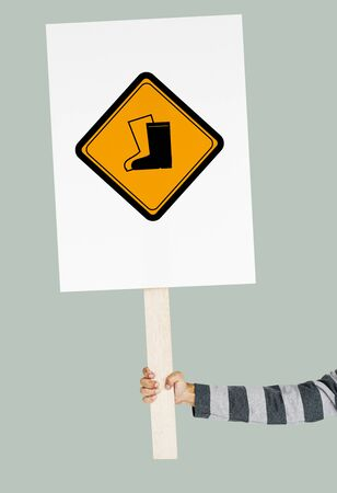 Studio Shoot Holding Banner with Safety Boots Attention Sign Stock Photo