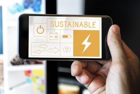 携帯電話で省エネ持続可能性発電のイラスト 写真素材
