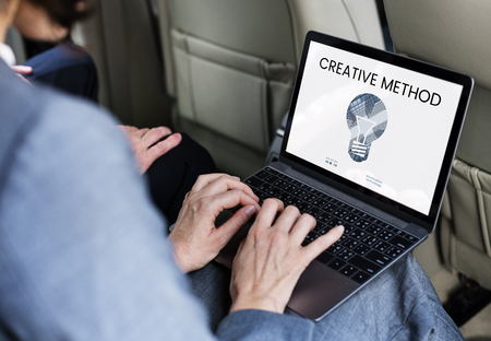 Graphic of creative ideas digital technology light bulb on laptop