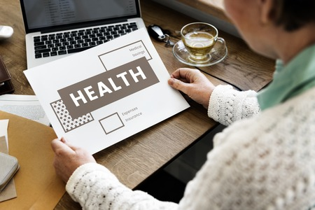 healthcare costs: Woman working on digital device network graphic overlay