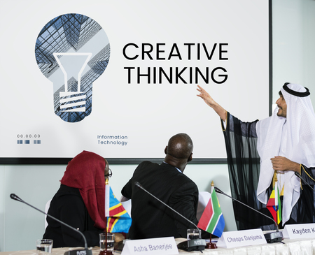 coworker: People with graphic of creative ideas digital technology light bulb Stock Photo