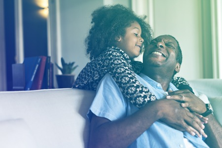 fondling: Lovely african family daughter hug her father