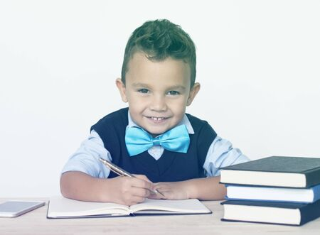 Young Schoolboy Writing Bookworm Education Stock Photo
