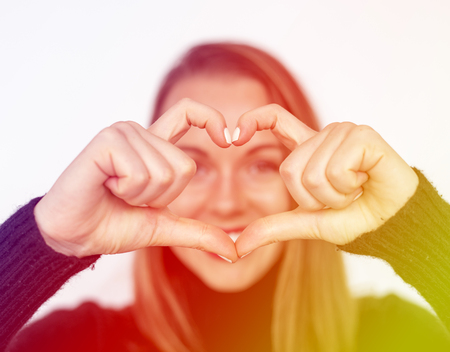 Happiness woman in love forming heart love hand sign Stock Photo