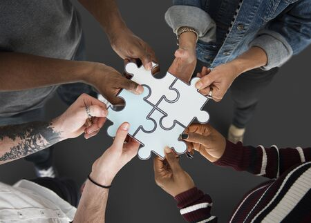 Group of people Holding Paper Jigsaw Puzzle