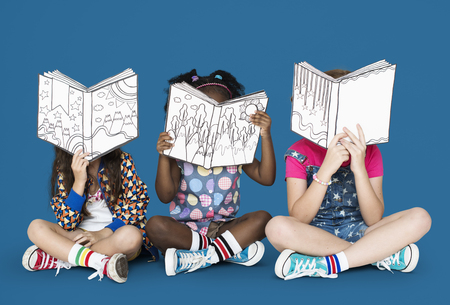 Little Children Reading Story Books Banco de Imagens