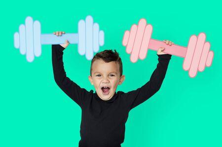 Little Boy Lifting Paper Crafted Dumb Bells Banco de Imagens - 80385987