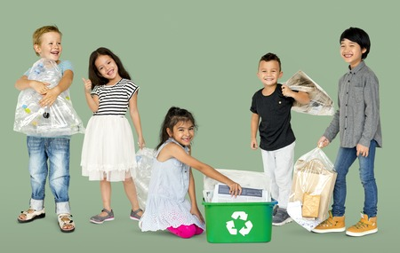 recycle reduce reuse: Diverse Group Of Kids Recycling Garbage Foto de archivo