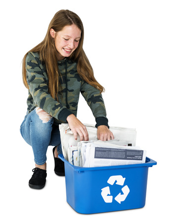 Ecology teenage girl separate trash for recycle