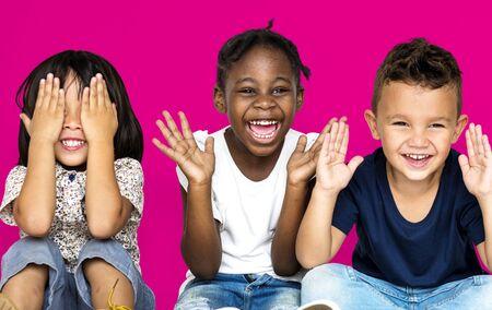 Group of happiness little children sitting on the floor Banco de Imagens - 80311278