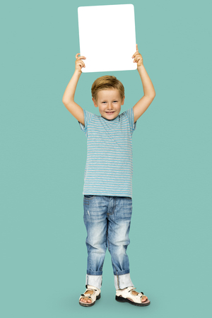 Caucasian Ethnicity Boy holding Placard