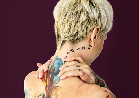 Woman with tattoos on her back Stock Photo