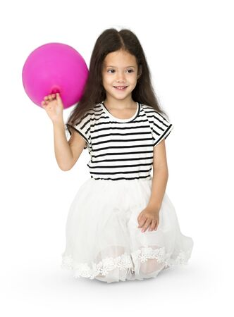Young girl is sitting holdong pink balloon Stock Photo