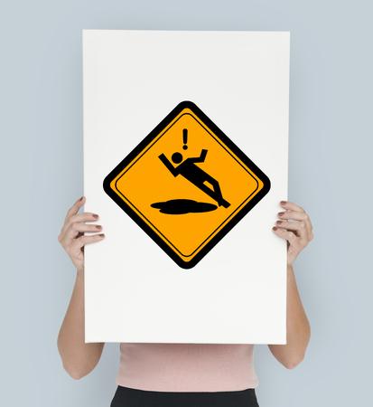 Studio Shoot Holding Banner met Slip Caution Sign