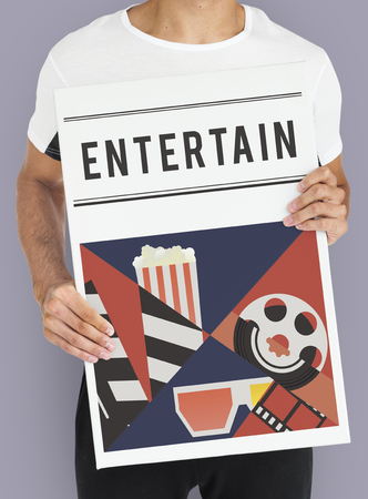 Man holding banner of movies theatre media entertainment