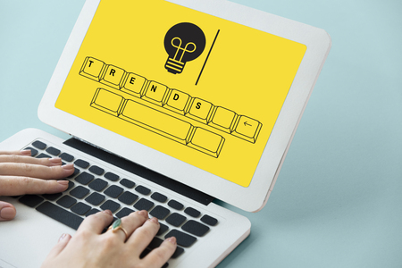 Trends on keyboard with light bulb icon