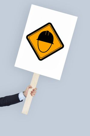 protester: Studio Shoot Holding Banner with Hot Surface Sign Stock Photo