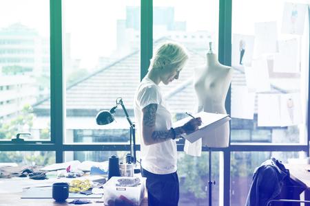 Fashion designer drawing cloth pattern