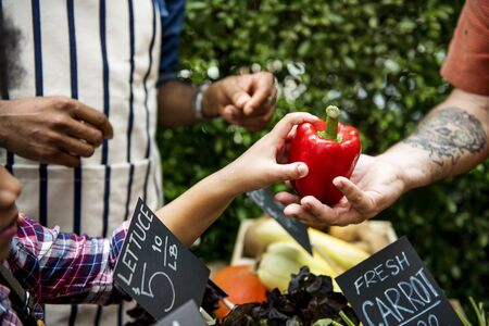 People Buying Vegetable From Shop at Market Stock Photo
