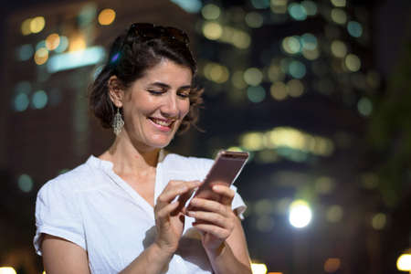 Adult Woman Using Mobile Phone Night Time Stock Photo