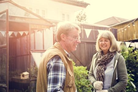 Senior Adult Couple Planting Organic Vegetable Hobby