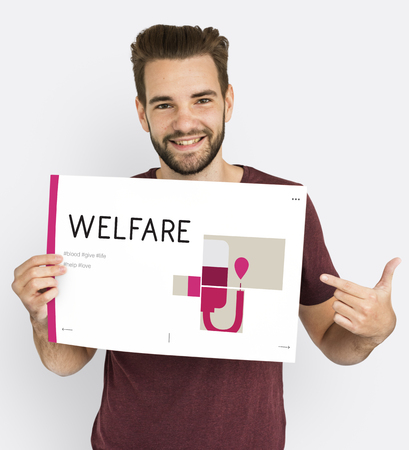 goodness: Man holding banner of blood donation campaign Stock Photo