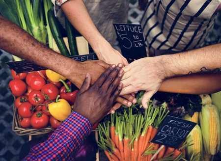 shopper: Hands stack for support power at grocery shio Stock Photo