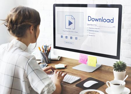 Download is copy data over the internet. Stock Photo