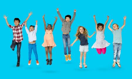 Diverse Group Of Kids Jumping and Having Fun 版權商用圖片 - 80390379