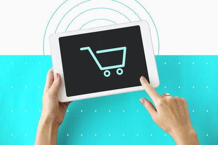 using tablet: Shopping Cart Commerce Graphic Symbol Icon