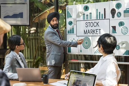Group of business people meeting financial investment chart Stock Photo