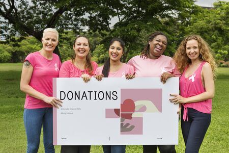 multiethnic: Group of women holding banner of charity donations campaign