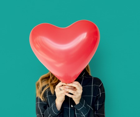 Young Adult Woman Face Covered with Heart Balloon