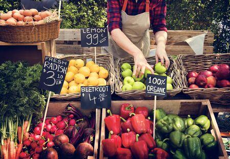 Greengrocer preparing organic fresh agricultural product at farmer market Stok Fotoğraf