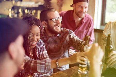 Group of people celebrate party with beer Stock Photo