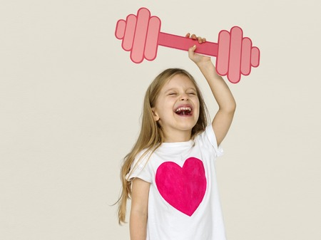 Little Girl Lifting Prapercraft Dumb Bells Banco de Imagens