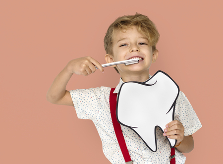 Little Boy Brushing Teeth Holding Papercraft Tooth