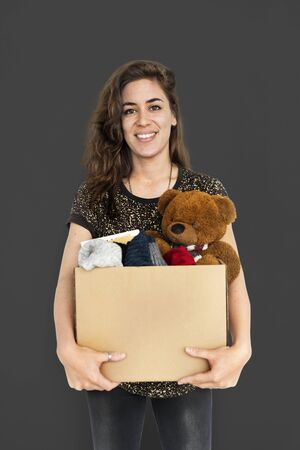 homemaker: Woman Studio Portriat Casual Carrying a Box Isolated Stock Photo
