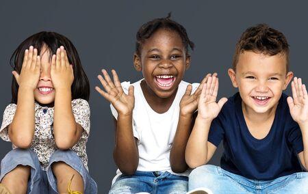 Group of happiness little children sitting on the floor Banco de Imagens - 80379470