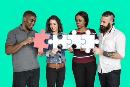 People are holding puzzle together Reklamní fotografie